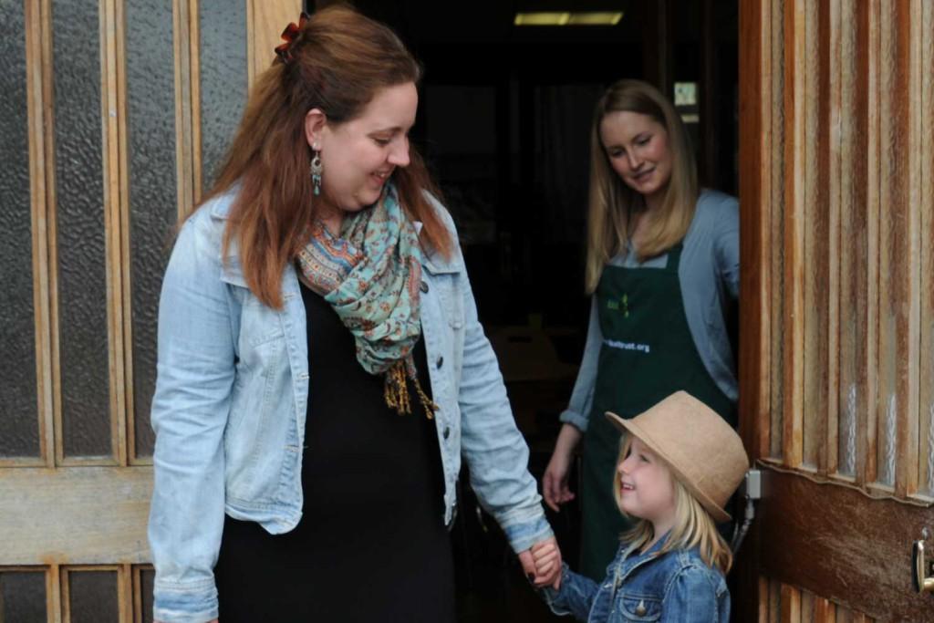 young family at foodbank entrance